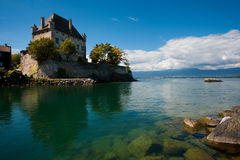 French Castle in Yvoire France. Yvoire's fortified castle is wonderfully reflected in the crystal clear waters of Lake Geneva Stock Photo