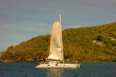 A french catamaran arriving in admiralty bay, bequia Stock Photography