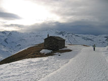 French chalet with a road full of snow Stock Images