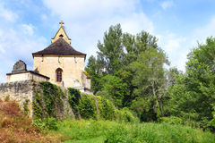 French chapel & cemetery on green hillside royalty free stock images