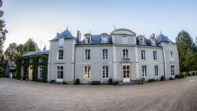 French Chateau under blue sky in France. A French Chateau with trees stands near Le Mans, June 2015, blue summer sky Stock Photography