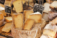 French cheese. Yellow french cheese at Provence market Stock Images