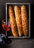 French cheese baguette with a red wine.Homemade freshly baked french baguettes. rustic style. long bread. Stock Photo