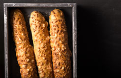 French cheese baguette with a red wine.Homemade freshly baked french baguettes. rustic style. long bread. Stock Images