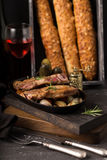 French cheese baguette with a red wine.Homemade freshly baked french baguettes. rustic style. long bread. Royalty Free Stock Photos