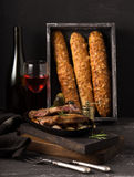 French cheese baguette with a red wine.Homemade freshly baked french baguettes. rustic style. long bread. Royalty Free Stock Photography