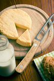 French cheese on cutting board Stock Photo