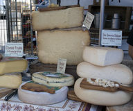 French cheese displayed for sale at the market in Arles france Stock Image