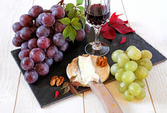 French cheese, grapes, walnuts and glass of red wine Stock Photography