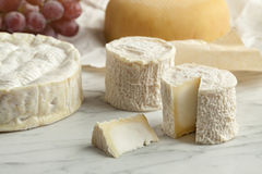French cheese platter. With camembert,goats cheese and grapes as dessert Stock Photo
