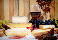 French cheese platter with wine. And grapes Stock Image