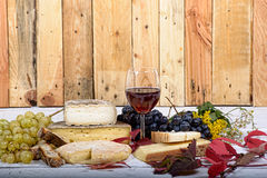 French cheese platter with wine Stock Photos