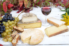 French cheese platter with wine Royalty Free Stock Photos