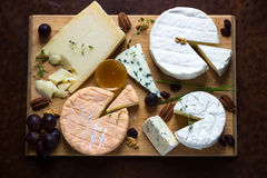 French cheese platter. On wooden background Royalty Free Stock Photo