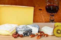French cheese and red wine. French cheese assortment with red wine stock images