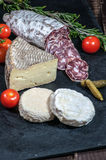French cheese, salami, tomatoes and pickles Stock Photography