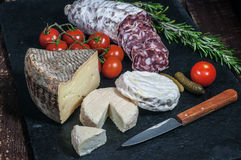 French cheese, salami, tomatoes and pickles Stock Photo