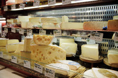French cheese shop in Paris with dozens of kinds of French chees Royalty Free Stock Photos