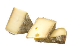 French cheese - Tomme. French cheeses - Tomme, isolated on white Royalty Free Stock Photography
