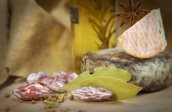 French cheeses with herbs. On wooden table stock image