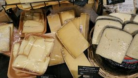 French cheeses. Portions of yellow and cream fresh French cheeses individually wrapped Royalty Free Stock Photography