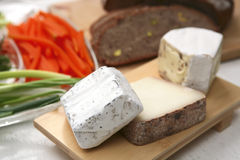 French cheeses on wood platter Royalty Free Stock Image