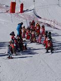 French children form ski school groups Royalty Free Stock Photos