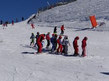 French children form ski school groups Royalty Free Stock Images