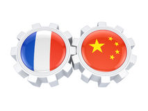 French and chinese flags on a gears. Stock Photos