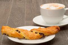 French chocolate twist with a cappuccino Stock Photography