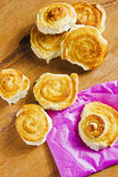 French cinnamon buns on wooden table. Royalty Free Stock Photo