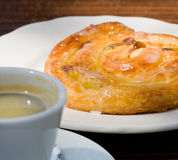 French cinnamon roll and espresso coffee Royalty Free Stock Image