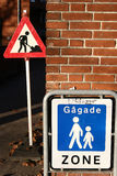 French city signs. French sign for pedestrian zone and workman warning sign with brick wall background stock photos