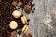 French coffee macaroons and chocolate on a rustic wood Royalty Free Stock Images