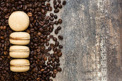 French coffee macaroons and chocolate on a rustic wooden Stock Photography
