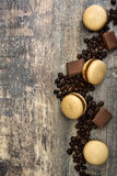 French coffee macaroons and chocolate on a rustic wooden Royalty Free Stock Photography