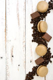 French coffee macaroons and chocolate on a white wooden Royalty Free Stock Photo