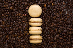 French coffee macaroons and coffee beans Royalty Free Stock Images