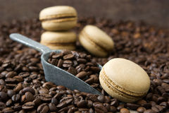 French coffee macaroons and coffee beans background Royalty Free Stock Images