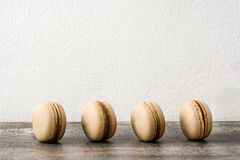 French coffee macaroons  on a rustic wooden Stock Photography