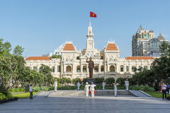 French colonial building Vietnam. Morning, The People's Committee building in Ho Chi Minh City (Saigon) with in front the statue of Ho Chi Min Royalty Free Stock Images