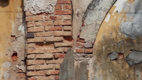 French Colonial: CU pan across textured wall of old French colonial building stock video