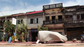 French Colonial: WS Vintage Retro Cambodia townhouses, Pan to street View stock video footage