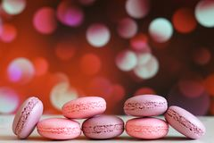 French colorful macarons background. Colorful macarons on colorful bokeh background. Royalty Free Stock Photos