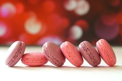 French colorful macarons background, close up. Bokeh background Stock Images