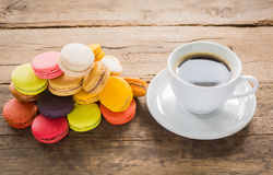 French colorful macarons with cup of coffee casual Royalty Free Stock Photography