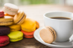French colorful macarons with cup of coffee casual Royalty Free Stock Image