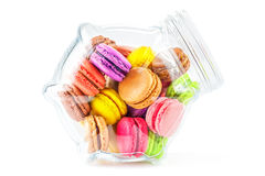 French colorful macarons in a glass jar Stock Images