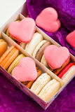 French colorful macarons with hearts in box Stock Images