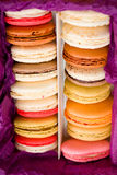 French colorful macarons with hearts in box Royalty Free Stock Image